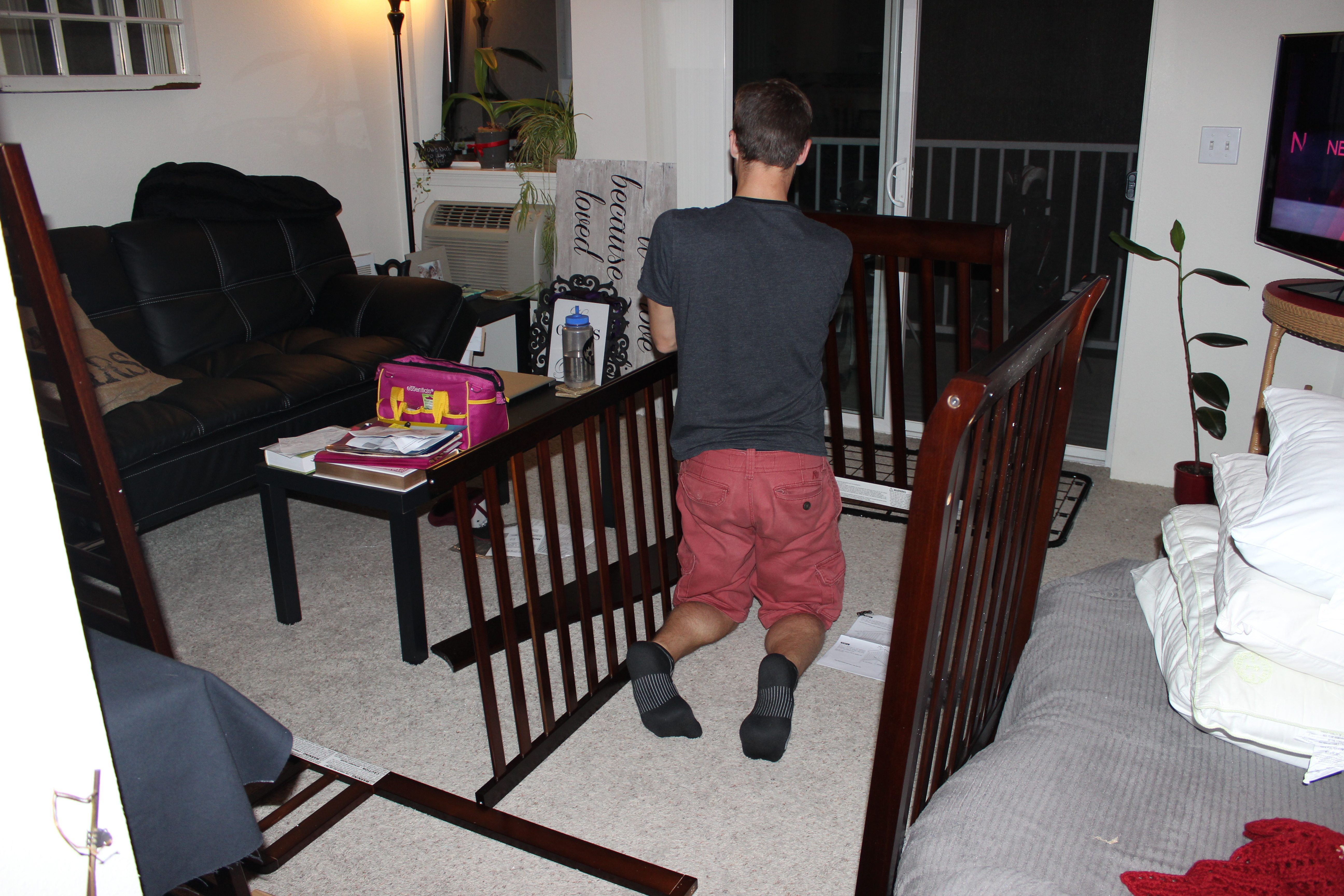 marc putting together the crib (2)